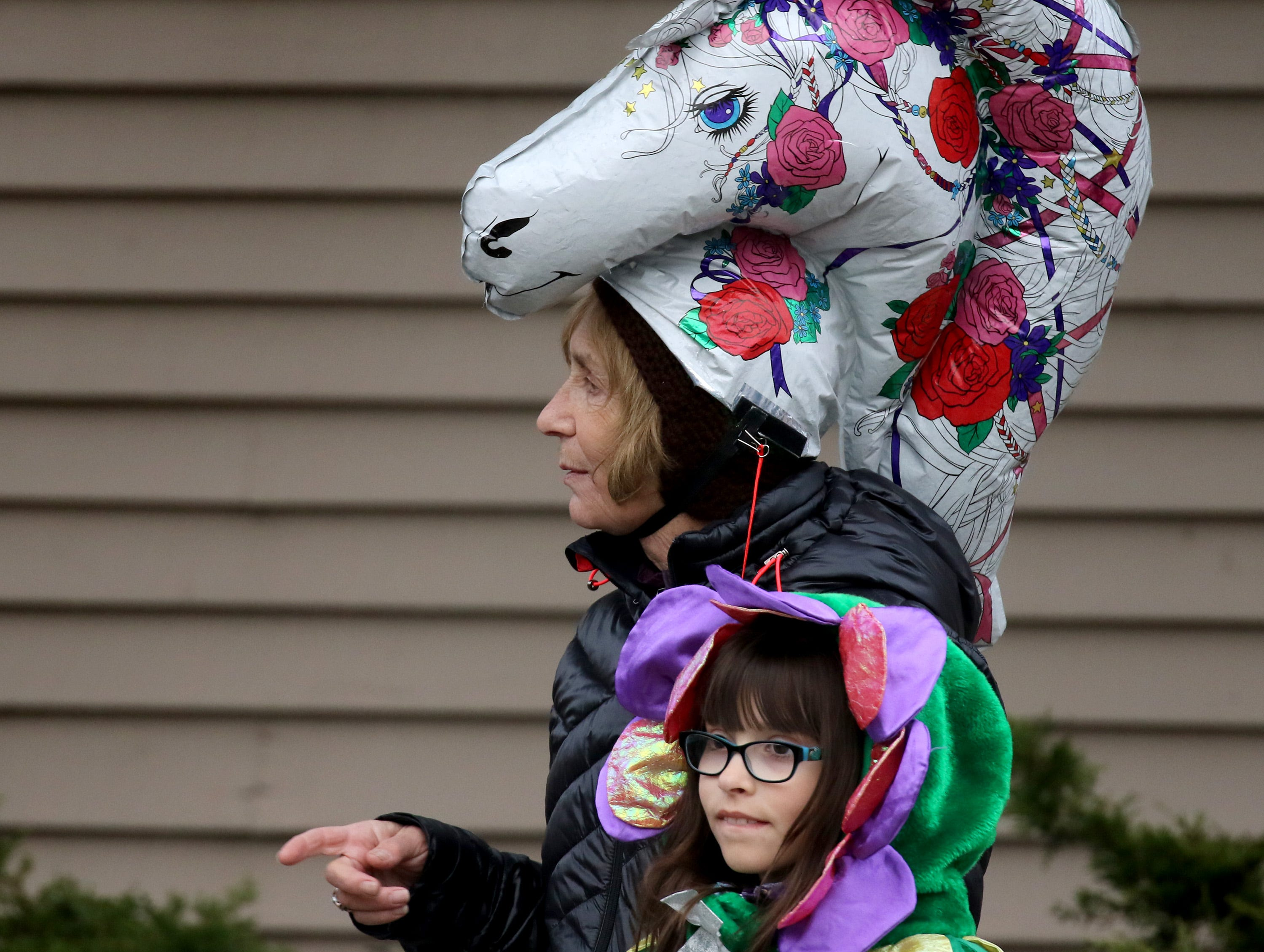 Elise Fuhr (front) and Barbara Fuhr make their way through the streets during the Menomonee Falls Downtown Trick or Treating on Oct. 25.