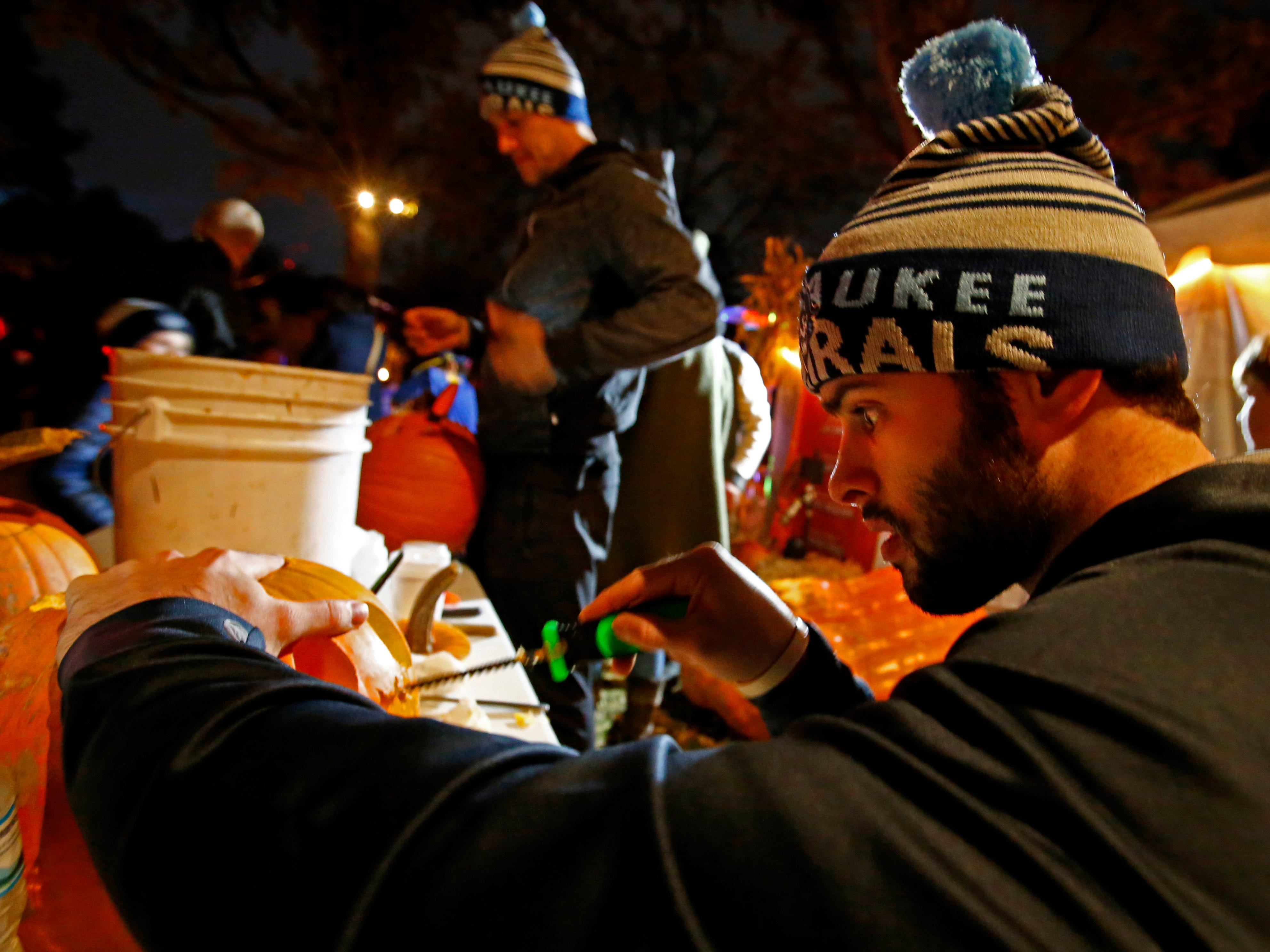 Colin Blackwell of Boston tries his hand at carving a pumpkin at the 32nd annual Whitefish Bay Great Pumpkin Festival at Old Schoolhouse Park, hosted by the Whitefish Bay Civic Foundation, on Oct. 25. The festival runs from 6 to 9 p.m. Wednesday, Oct. 24, through Sunday, Oct. 28.