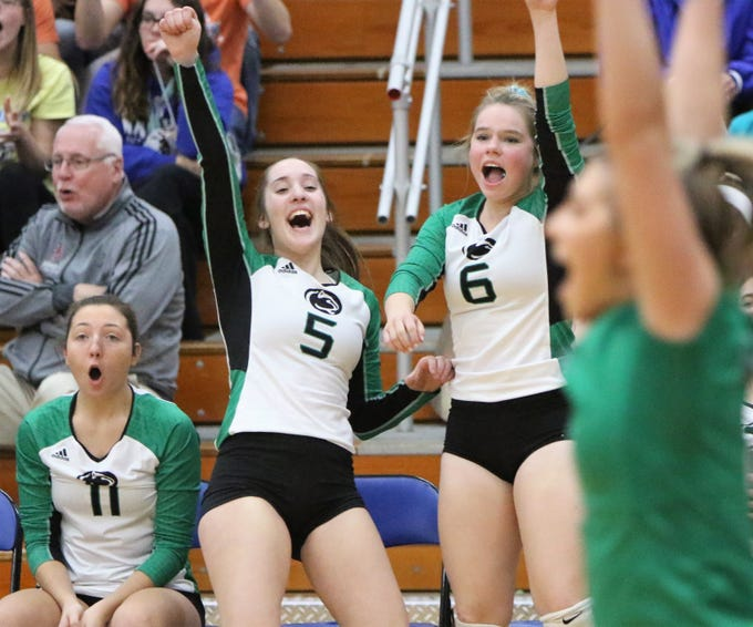 Greendale's Chloe Wolf (5) and Lily Nogalski (6) celebrate a point against Oak Creek in a WIAA sectional semifinal on Thursday.