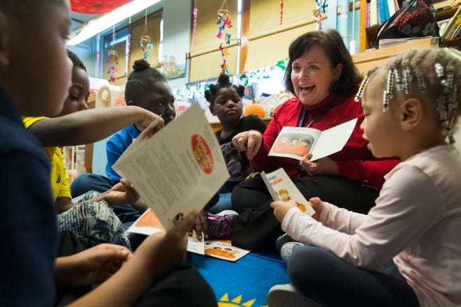 Principal Shannon Kilsdonk reads to 4K students Friday at Hartford Avenue School in Milwaukee. Kilsdonk is one of 28 principals taking part in the new Wisconsin Urban Leadership Insititute, a yearlong effort to address racial achievement and opportunity gaps in the state's largest school districts.