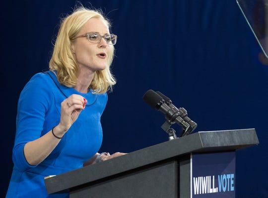 State Treasurer Sarah Godlewski, then a candidate for the post, speaks at a Democratic rally in October at North Division High School in Milwaukee.