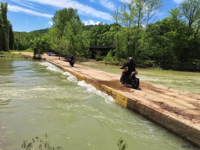 Motorcyclists ride across the Ponca low-water bridge.