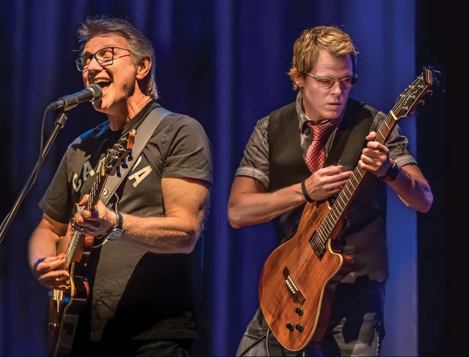Rik Emmett (left) and Dave Dunlop will perform an acoustic show at the Newton Theatre on Saturday, November 10.  Emmett co-founded the Canadian hard rock band Triumph in 1975.  Since 1988, he has had a solo career playing jazz, bluegrass, the blues, and other genres.