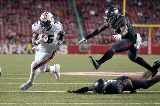 Auburn running back Kamryn Pettway (36) rushes for a touchdown against Arkansas on Oct. 21, 2017, in Fayetteville, Ark.