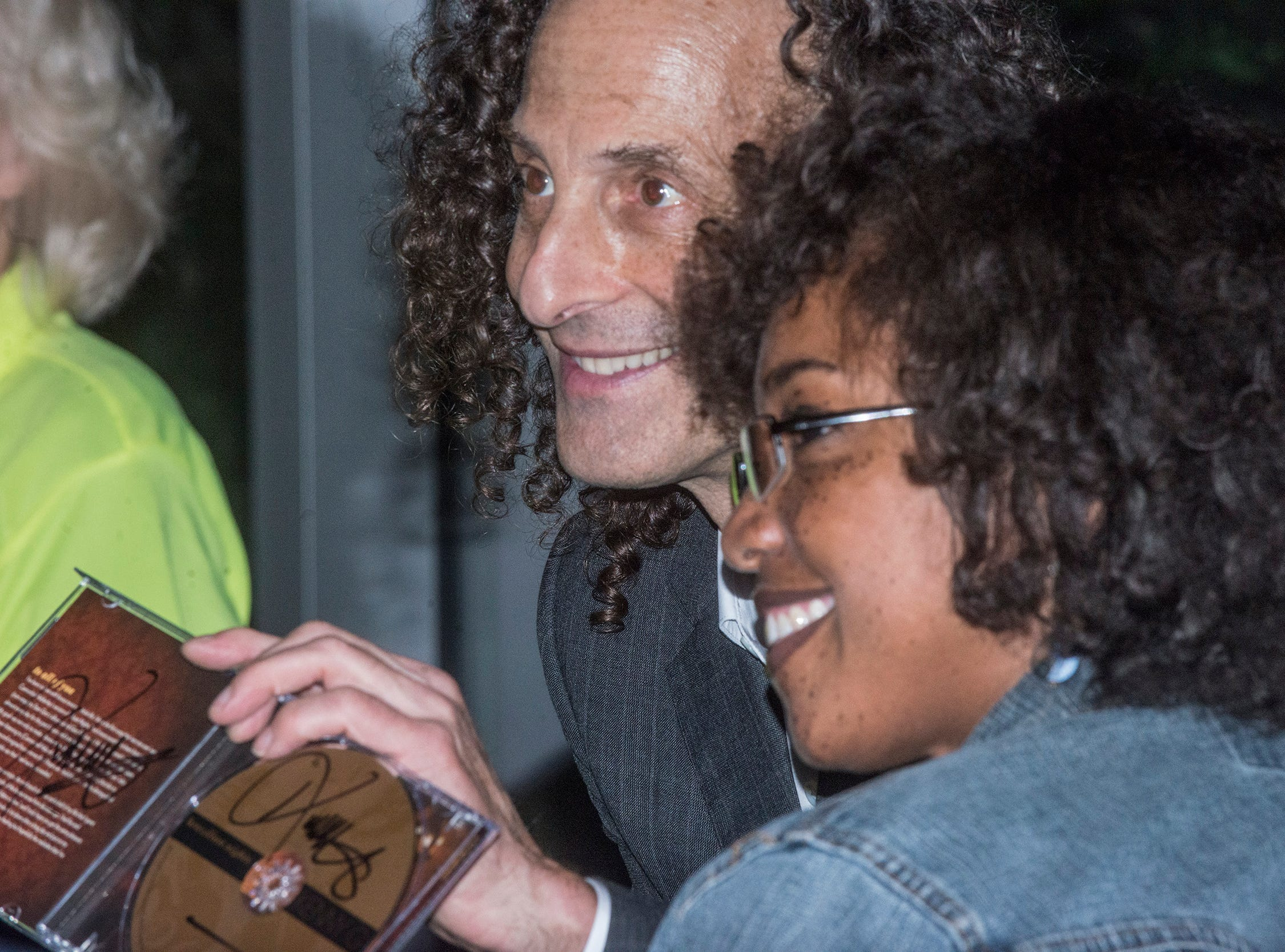 Kenny G autographs his CDs for fans on Thursday, Oct. 25, 2018, at the Montgomery Performing Arts Centre.