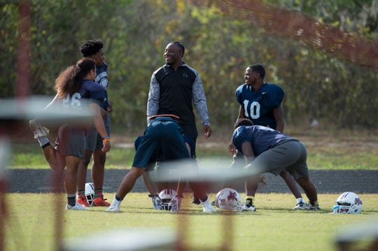 Kamryn Pettway, former Auburn running back, stretches out with players at Park Crossing High School in Montgomery, Ala., on Wednesday, Oct. 24, 2018. Pettway joined his former coach Angelo Wheeler, head coach at Park Crossing, after a failed attempt at making a NFL roster.