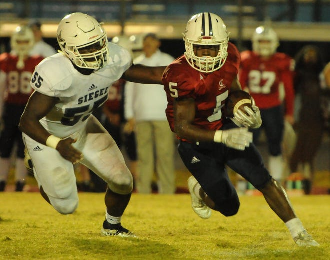 Siegel's Khalil Wilson (55) chases Cookeville's Jaeden McAllister (5) during the second quarter of Thursday's game.