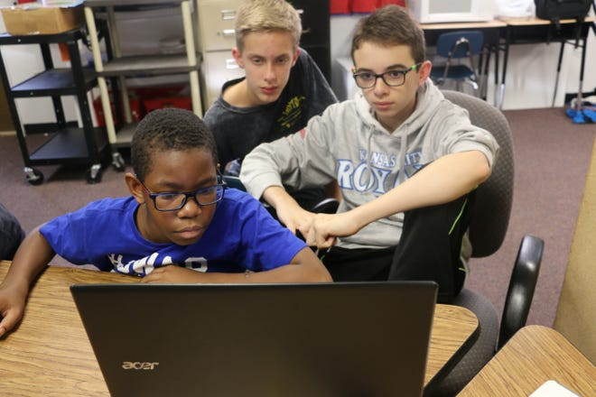Emanuel Coleman, Brody King and Nate Caiazzo, use computer-aided drafting software to work on a robotic project at Thurman Francis Arts Academy.