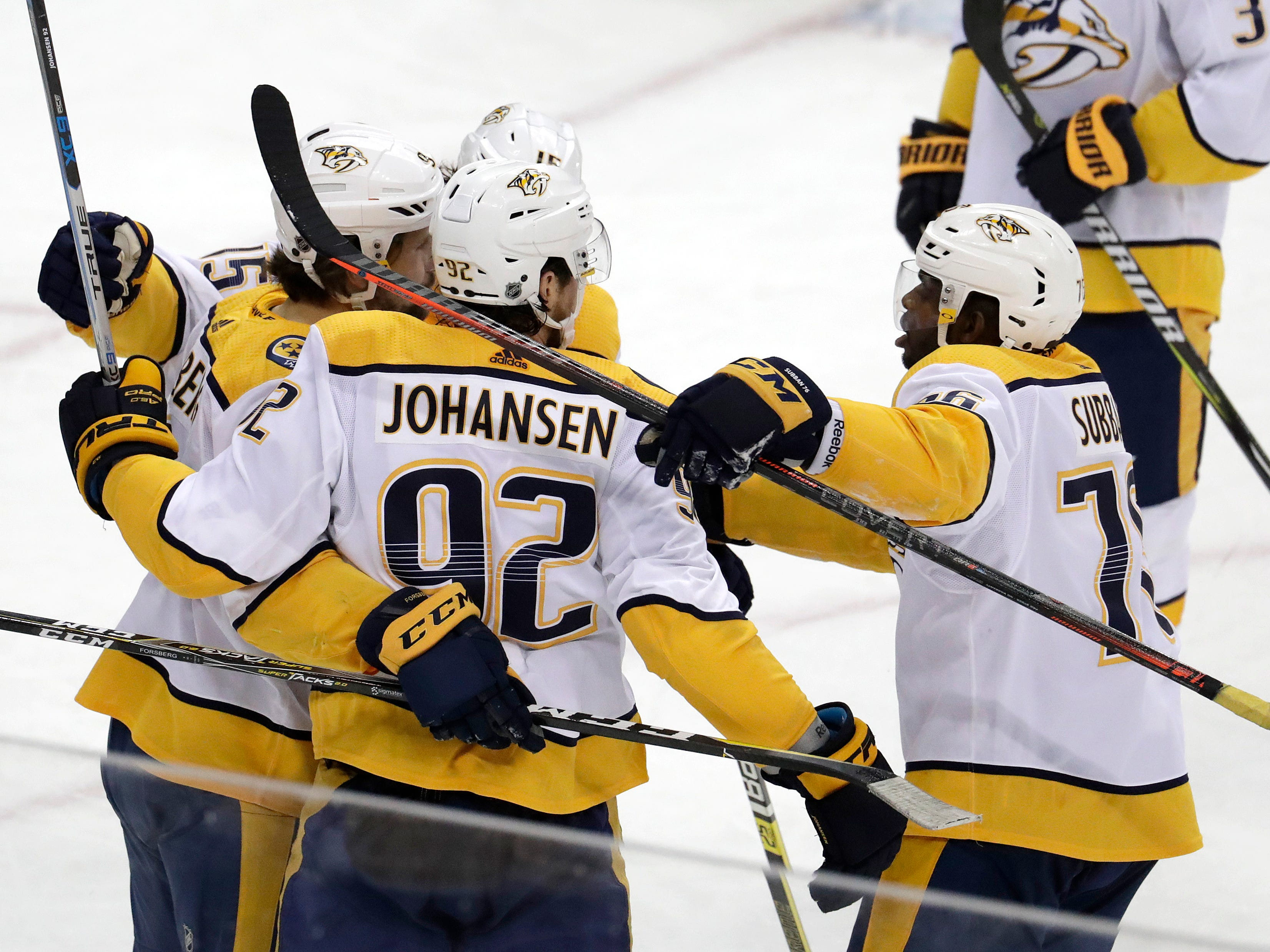 Nashville Predators left wing Filip Forsberg, left, of Sweden, celebrates his goal against the New Jersey Devils with teammates during the third period of an NHL hockey game, Thursday, Oct. 25, 2018, in Newark, N.J. The Predators won 4-3 in overtime.