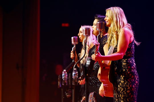 (L to R) Ashley Monroe, Angaleena Presley and Miranda Lambert of The Pistol Annies perform at the Ryman Auditorium Thursday, Oct. 25, 2018, in Nashville, Tenn.