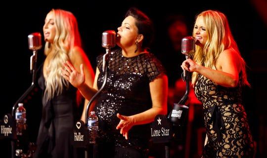 From left, Ashley Monroe, Angaleena Presley and Miranda Lambert of The Pistol Annies perform at the Ryman Auditorium on Oct. 25, 2018.