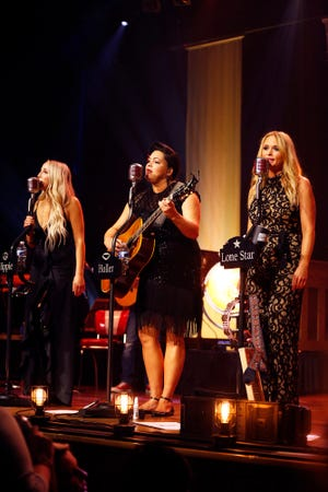 Ashley Monroe, left, Angaleena Presley and Miranda Lambert of the Pistol Annies perform at the Ryman Auditorium on Thursday, Oct. 25, 2018, in Nashville.