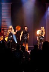 Ashley Monroe, left, Angaleena Presley and Miranda Lambert of the Pistol Annies perform at the Ryman Auditorium on Oct. 25, 2018, in Nashville.