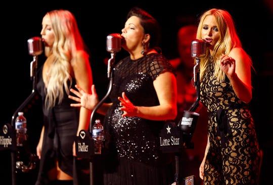Ashley Monroe, left, Angaleena Presley and Miranda Lambert of the Pistol Annies perform at the Ryman Auditorium on Oct. 25, 2018.