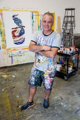 Venezuelan-American artist Arturo Correa poses for a portrait on Wednesday, October 24, 2018, at his studio in Naples. Correa says that each of his paintings serves as a conversation between himself and people looking at his work.
