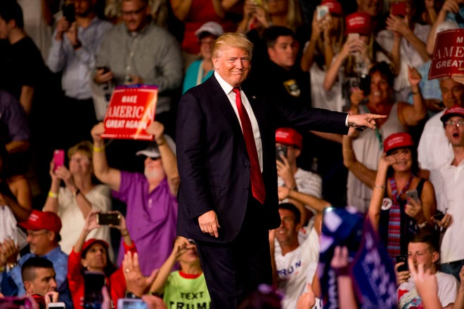 In this file photo, Donald Trump makes his grand entrance into Germain Arena September 19, 2016, in Estero, Florida.