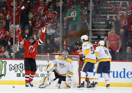 Oct 25, 2018; Newark, NJ, USA; New Jersey Devils right wing Kyle Palmieri (21) celebrates after a goal against Nashville Predators goaltender Juuse Saros (74) during the first period at Prudential Center.