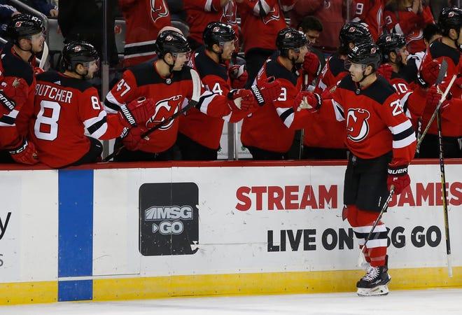 Oct 25, 2018; Newark, NJ, USA; New Jersey Devils defenseman Damon Severson (28) celebrates after scoring a goal against Nashville Predators during the first period at Prudential Center.