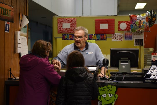 Bill Kaufman helps customers on his last day of work at the Oradell Post Office. Kaufman is retiring after 35 years of service on Friday October 26, 2018.