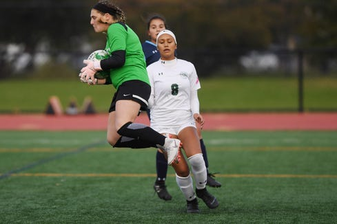 Wayne Valley vs. DePaul in the Passaic County soccer finals at Clifton Stadium on Friday, October 26, 2018. WV goalie #0 Arden Lembryk makes a save in the first half. DP #8 Jazlyn Oviedo looks on.