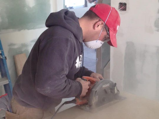 Todd Adrian, of Bloomfield, New Jersey, helps rebuild a home in Broad Channel, New York, after Superstorm Sandy. The Team Rubicon regional leader is a Mahopac, New York, native.