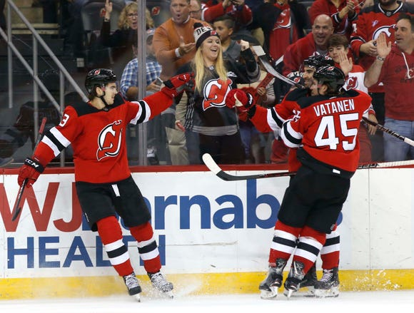 Oct 25, 2018; Newark, NJ, USA; New Jersey Devils center Nico Hischier (13) celebrates after scoring a goal against Nashville Predators during the second period at Prudential Center