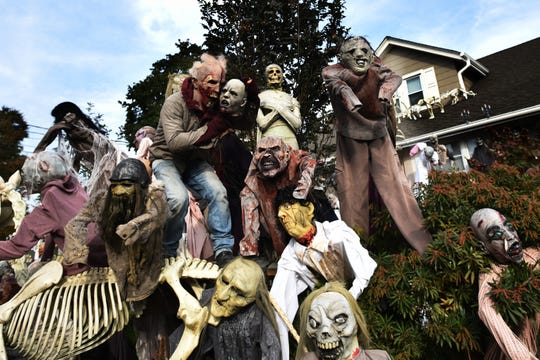 Antonio Rodrigues goes all out for Halloween decorating his home with hundreds of spooky creatures. Dressed as a zombie Antonio Rodrigues poses for a photo in front of his Hawthorne home on Friday October 26, 2018.