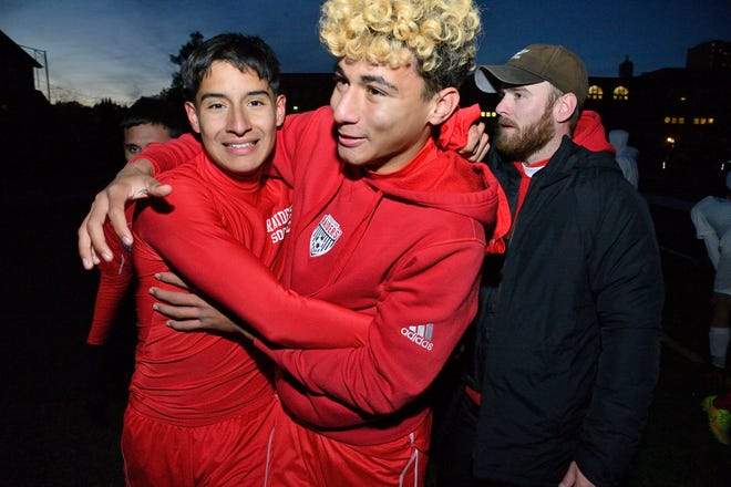 Cliffside Park players Christopher Lazo and Caio Ferreira celebrate their win over Mahwah in overtime in Cliffside Park.