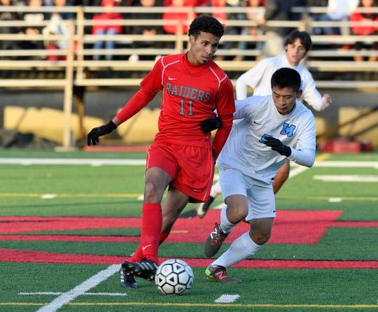 Cliffside Park's Gabriel Costa (11) moves the ball down field in the game against Mahwah in Cliffside Park.