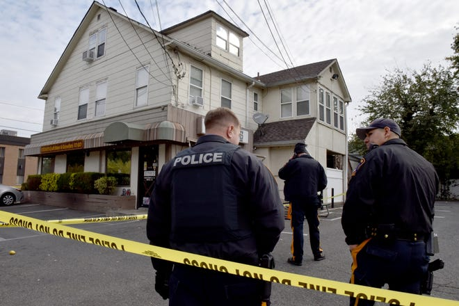 Fair Lawn Police set up a crime scene around an apartment above a bar on Maple Ave in Fair Lawn on Friday morning October 26, 2018.