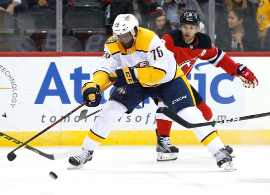 Oct 25, 2018; Newark, NJ, USA; Nashville Predators defenseman P.K. Subban (76) defends against New Jersey Devils left wing Taylor Hall (9) during the first period at Prudential Center.