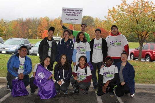 Team members support the fight against Alzheimer's during the 2016 walk.