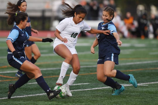 Wayne Valley vs. DePaul in the Passaic County soccer finals at Clifton Stadium on Friday, October 26, 2018. (center) DP #10 Bryana Pelayo in the first half. (right) WV #12 Courtney Delerba.