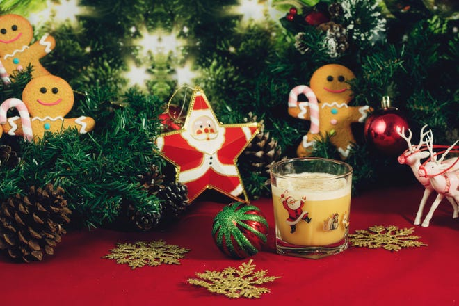 Miracle's Gingerbread Flip cocktail comes in a vintage Santa-inspired glass.