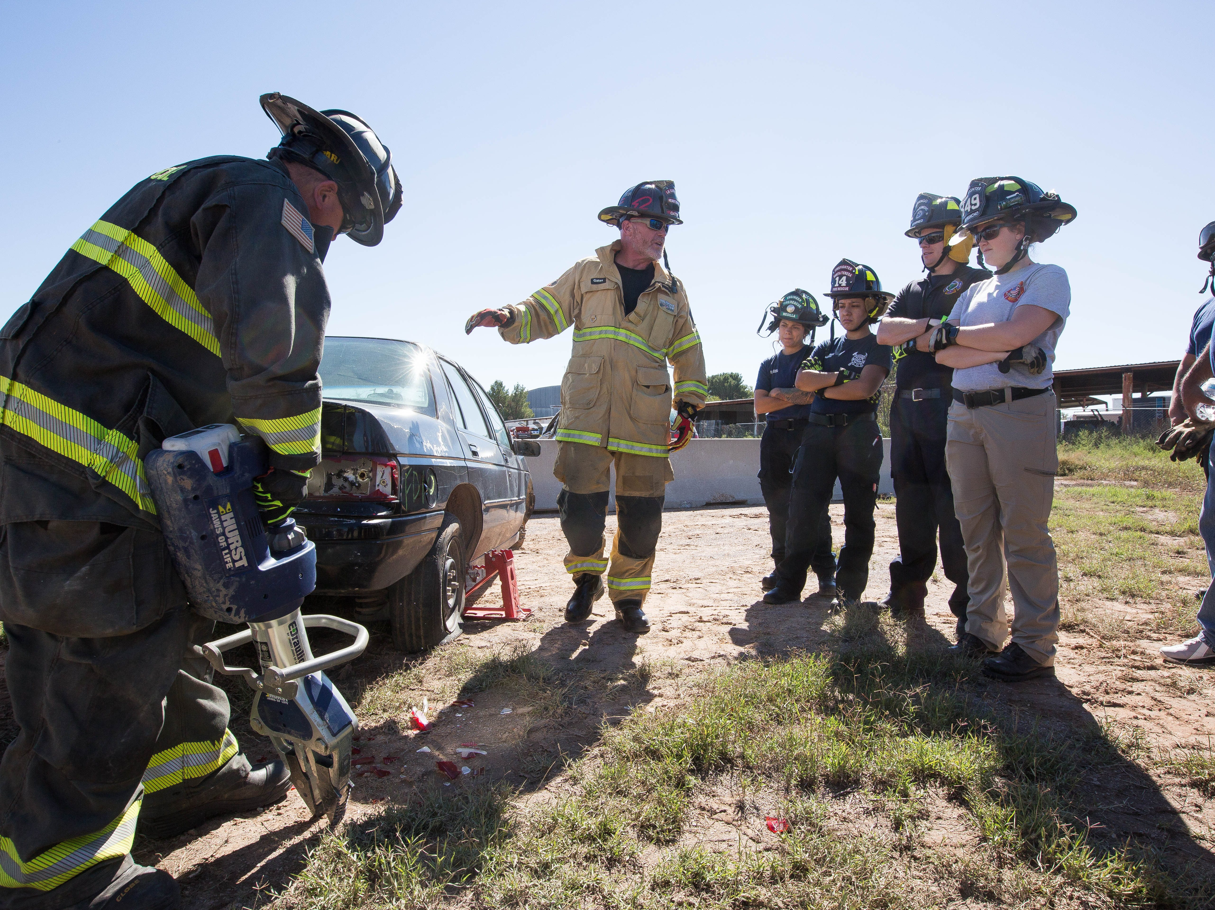 Jeff Gates, center, an instructor from Curtis Tools for Heroes, with help from Brian Bird, left,  explains where a first responder might look to open a truck using a jaws of life tool, during a Extraction tactics demonstration Friday October 26, 2018. This demonstration is part of a three-day advanced auto extraction class, providing first responders with training different types of vehicles and accidents they will encounter while on the job.