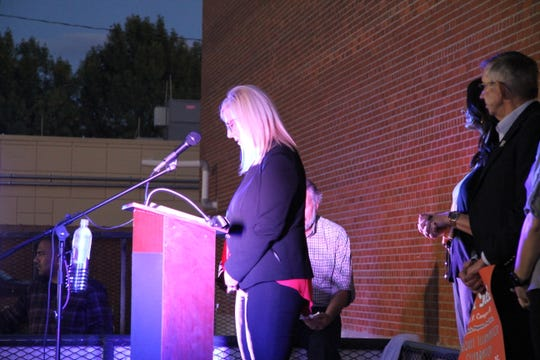 Karla Hamel, director of Carlsbad MainStreet, ahead of the lighting of the Cavern Theater marquee.