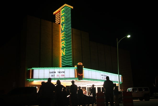 The Cavern Theater marquee, refurbished, lights up downtown Carlsbad for the first time in decades.