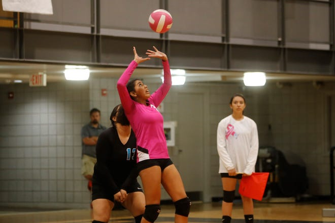 Navajo Prep's Hailey Martin passes the ball to teammates against Tohatchi during Thursday's District 1-3A volleyball match at the Eagles Nest. Visit daily-times.com to see the latest sports video highlights and photo galleries.