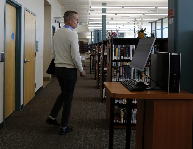 Director Christopher Schipper walks through the San Juan College Library Friday. The library is one of several in San Juan County that would benefit from the passage of one of four general obligation bond questions on the Nov. 6 ballot.