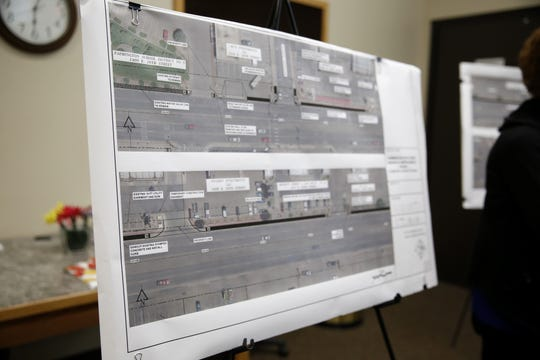 Designs for future construction on 20th Street are displayed Thursday during a public meeting at Farmington City Hall.