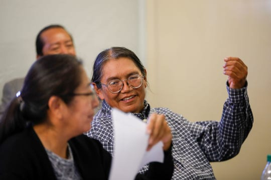 Former Navajo Nation presidential candidate Vincent H. Yazzie talks with his attorney, Bernadine Martin, on Sept. 26 at the Navajo Nation Office of Hearings and Appeals in Window Rock, Ariz.