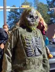 A scary skeleton trick or treating in midtown Ruidoso.