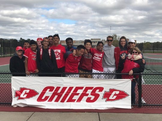 Longtime Canton Chiefs tennis coach Barb Lehmann (standing, far right) is retiring from coaching after nearly three decades on the job.