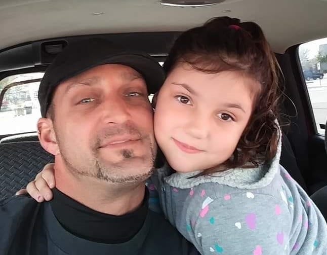 Joseph Demel with his daughter Keison, in a photo taken this year.