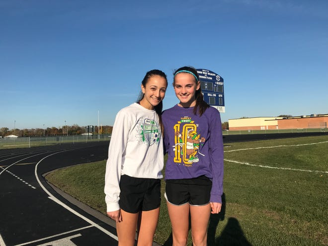 Oshkosh West freshmen Taylor Guido, left, and Bailey Wright will compete at the state cross country meet Saturday in Wisconsin Rapids.
