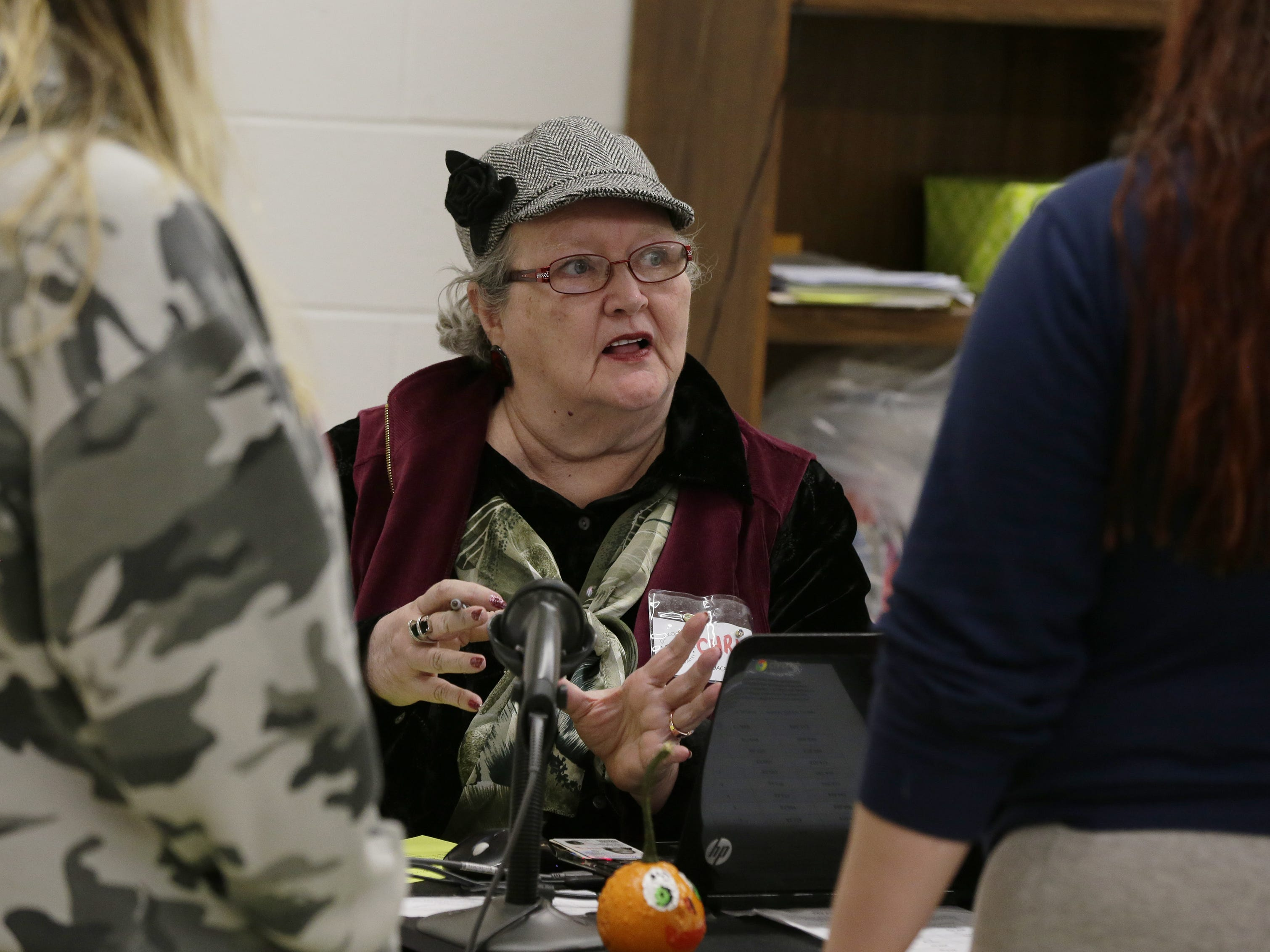 Chris Moore checks in clients before they can get food Wednesday, Oct. 24, 2018, at the Oshkosh Area Community Pantry. Moore volunteers and uses the pantry, which serves over 2,000 families each month.