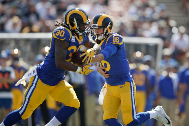 Los Angeles Rams quarterback Jared Goff hands the ball to Todd Gurley during an NFL football game against the Seattle Seahawks Sunday, Oct. 8, 2017, in Los Angeles. (AP Photo/Jae C. Hong)