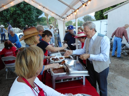 Serving line at the Los Compadres Deep Pit Barbecue in 2017.