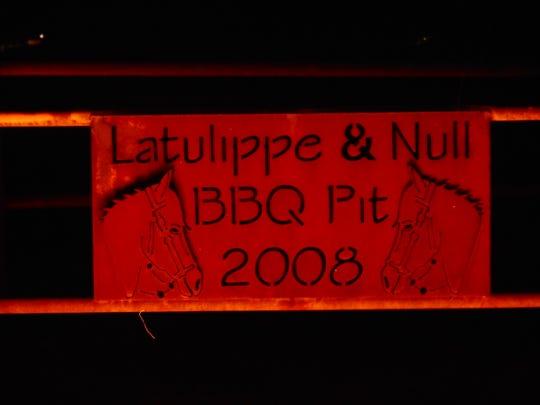Deep Pit Barbecue dedication plaque.
