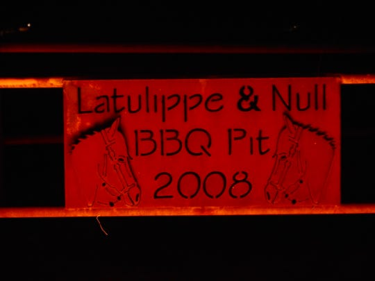 Deep Pit Barbecue dedication plaque.